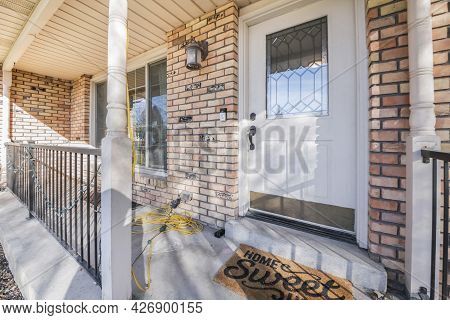 Front Door With Ornate Glass Panel And A Home Sweet Home Doormat
