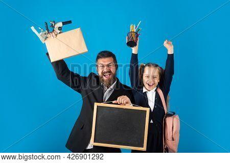 Tutor With School Girl With Successful Exercise Finish. Funny Little Schoolgirl In School Uniform Ha