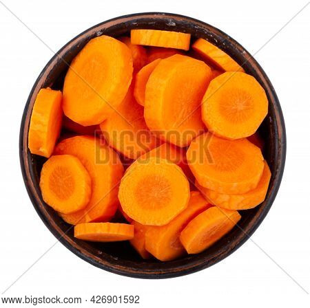 Sliced Carrots In A Bowl Isolated On White Background. Fresh Cut Crisp Pieces Of  Carrots, A Root Ve