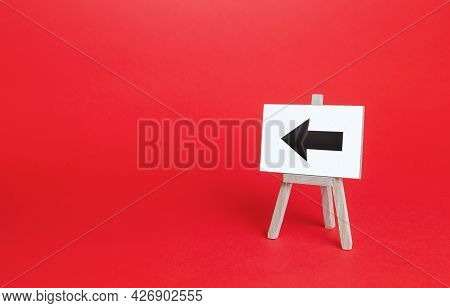 Left Arrow Easel Sign. Direction Pointer. Hint, Help In Navigation. Minimalism. Advertising And Attr