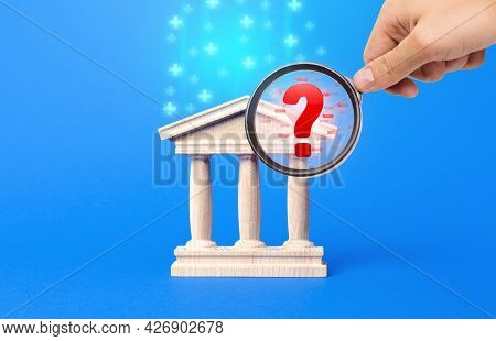 Finding Financial Irregularities In The Bank During The Inspection. Inspectors Hand With A Magnifyin