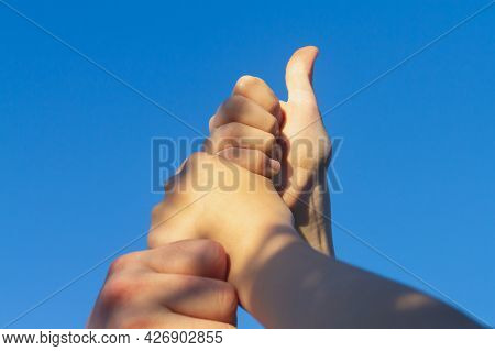 People Put Their Hands On Each Other As A Sign Of Reciprocity And Command.