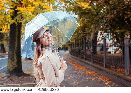 Happy Young Woman Walking Outdoors Under Transparent Umbrella During Rain. Fall Season Activities. S