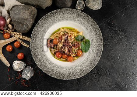 Boiled Tagliatelle Pasta With Octopus And Cherry Tomatoes