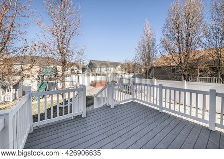 Deck Of A House With A View Of A Playground In The Backyard