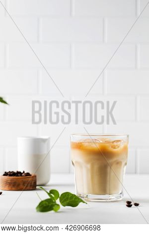Cold Coffee With Ice And Cream On A White Tile Background. Homemade Cold Latte.