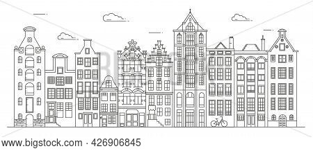 Amsterdam Old Style Houses. Typical Dutch Canal Houses Lined Up Near A Canal In The Netherlands. Bui