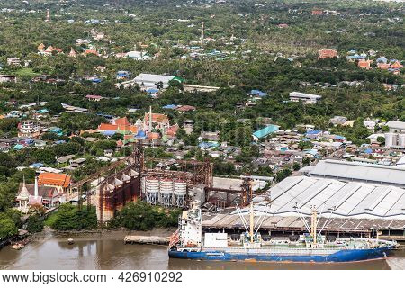 Aerial View Of Green Forest Area Of Bang Kachao Overlooking Thai Temples, Petroleum Refinery And Car