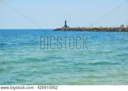 Harbor Entrance At The Sea Port Lighthouse, Copy Space - Tunisia, Sousse, El Kantaoui 06 19 2019