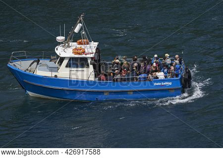 Martin\'s Haven, Pembrokeshire, Wales - July 13, 2021: Boat Filled With Visitors Departing From The