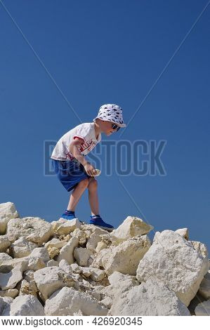 Russia, Moscow Region, 10.07.2021 - Boy Are Looking For Fossils. Hobby Is Paleontology. Walks On Pil