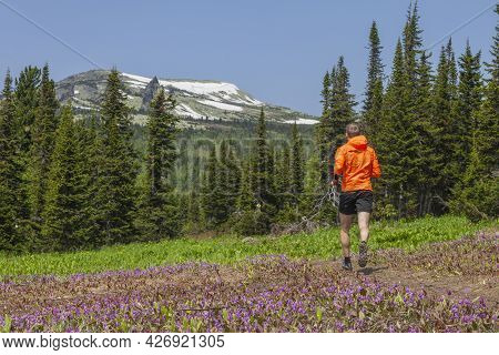 Young Man Doing A Running Workout In The Mountains