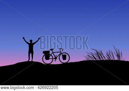 Dark Silhouette Of Touring Bike Cyclist With Bicycle On Mountain With Sunset Background. Biker Raise