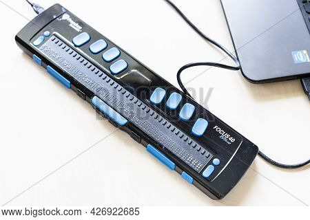 Moscow, Russia - June 5, 2021: Focus 40 Blue Braille Display Connected To Laptop. Freedom Scientific
