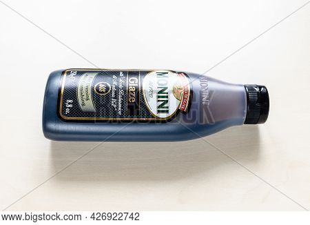 Moscow, Russia - June 10, 2021: Lying Bottle Of Monini Glaze With Aceto Balsamico Di Modena Igp On P