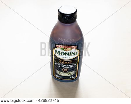 Moscow, Russia - June 10, 2021: Bottle Of Monini Glaze With Aceto Balsamico Di Modena Igp On Pale Bo