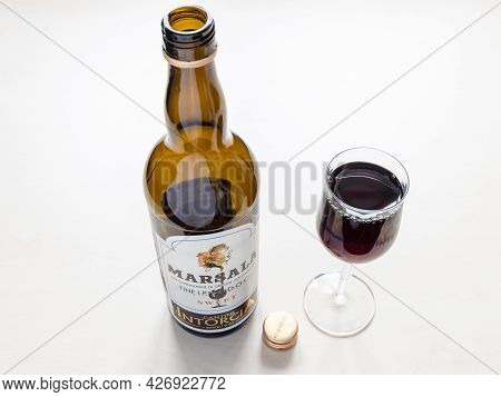 Moscow, Russia - June 10, 2021: Wine Glass And Open Bottle Of Sweet Marsala From Cantine Intorcia. M