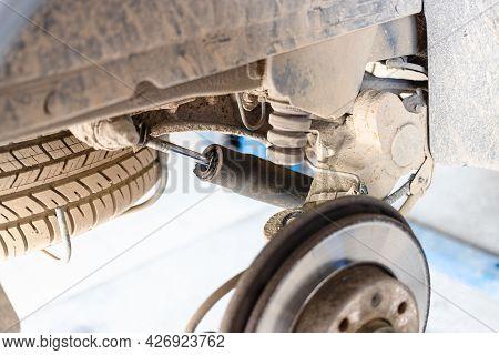 Broken Rear Shock Absorber On Old Car (focus On Car Shock Absorber Rod)