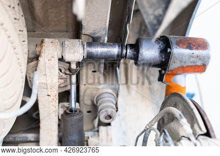 Disassembling Fastening Of Broken Car Shock Absorber (focus On Pneumatic Screwdriver)