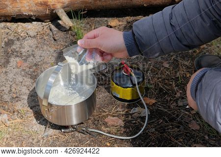 Camping Food Making In Journey. Tourist Food In Outdoor Activities. Soup In The Forest For Trevelers