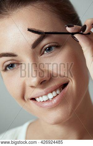 Eyebrows Correction. Shape. Beautiful Young Woman With Perfect Natural Eyebrows And Eyelashes.  Natu