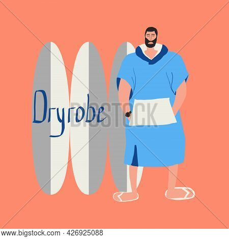 Man Surfer In Blue Dry Robe Stands Near Surfboards
