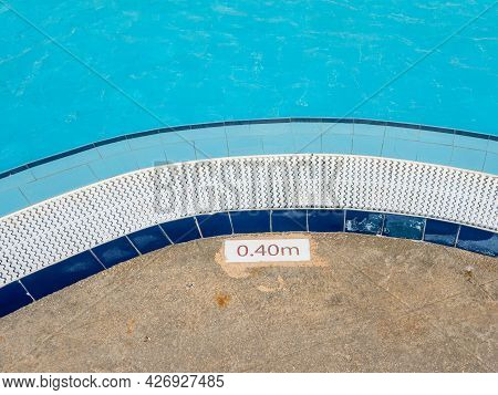 The Edge Of The Pool With Indication Of The Depth Of The Descent. Near The Pool With Clear Blue Wate