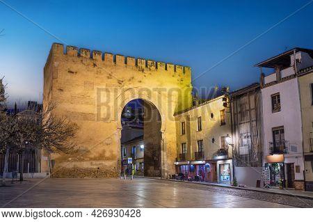 Granada, Spain. View Of Historic Gate Of Elvira (puerta De Elvira) At Dusk