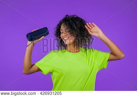 Mixed Race Woman Listening To Music By Wireless Portable Speaker - Modern Sound System. African Lady