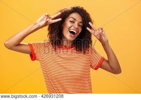 Nobody Gonna Spoil My Perfect Mood. Portrait Of Happy Optimistic Attractive Dark-skinned Female Mode