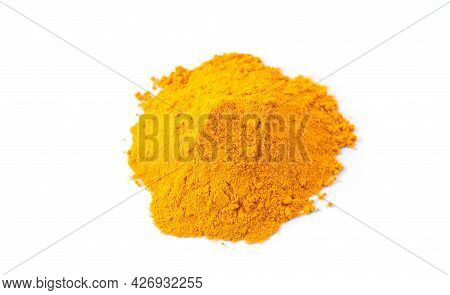 Pile Of Turmeric Or Curcuma Powder Isolated On White Background Wih Copy Space. Top View