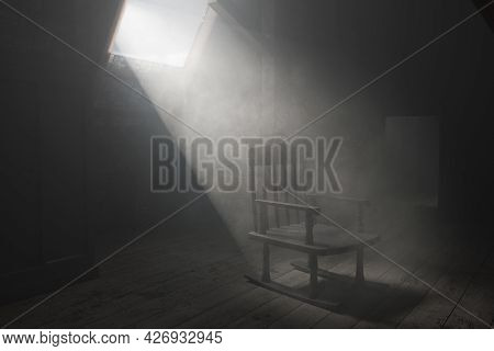 3d Rendering Of Old Rocking Chair At Dark Attic With Light Ray. Concept Age And Past