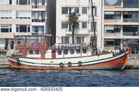 Old Boat In Bosphorus Strait Side Of Istanbul City, Turkey
