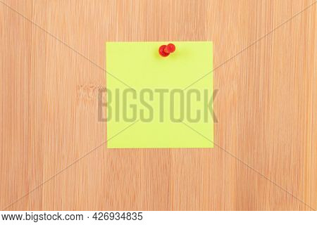 Yellow Sticky Note Pinned To The Wooden Message Board. To Do List Reminder In Office. Blank Memo Sti