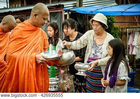 People To Give Alms To A Buddhist Monk In The Morning.