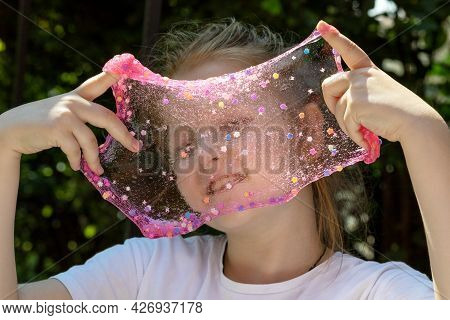 Little Girl Playing With Slime In Nature, Slime Texture