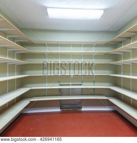 Square Frame Interior Of A Food Storage Room With Empty Shelves At The Basement
