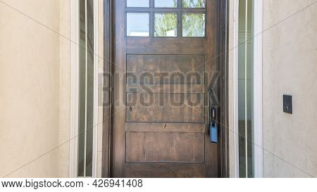 Pano Exterior Of A Front Door With Glass Panels And Doormat
