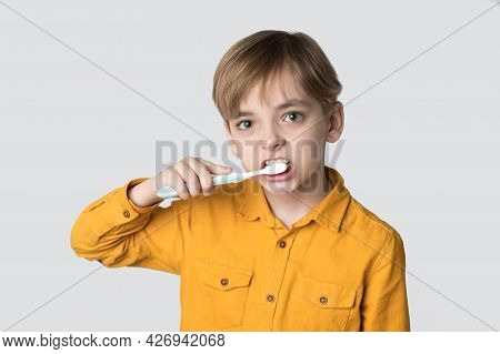 Caucasian Boy Brushes His Teeth With A Toothbrush. Hyena Oral Cavity, Dental Health. White Isolated