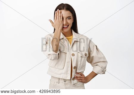 Beatiful Adult Woman Cover Half Of Face, One Eye Behind Palm, Smiling And Looking Confient, Wearing