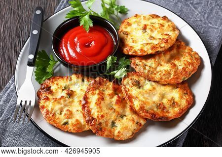 Close-up Of Cheesy Chicken Fritters, Chicken Breast Patties Served With Tomato Sauce On A Plate, Hor