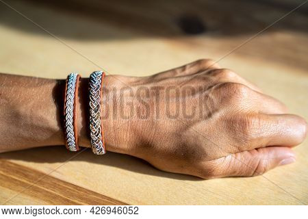 A Close Up View Of A Caucasian Woman Hand And Forearm Withvtraditional Silver And Leather Sami Brace