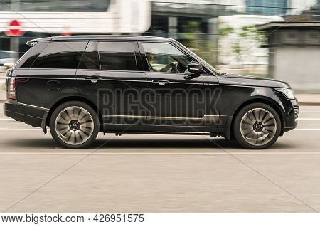 Moscow, Russia - May 2021: Range Rover L405 Suv Vehicle On The City Road. Fast Moving Black Car On M