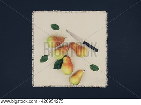 Pear With Knife And Leaves . On Wooden Background. Top View. Making Homemade Pear Cider. Top View. F