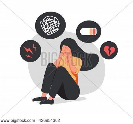Young Woman Who Suffers From Mental Health Diseases Is Sitting On The Floor. Girl Surrounded By Symp