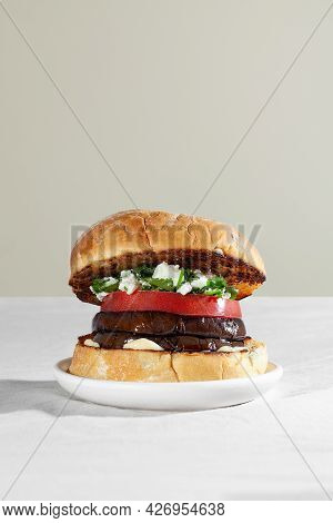 Vegan Sandwich Burger With Roasted Eggplant, Feta Cheese And Cilantro. Plant Based Food Concept