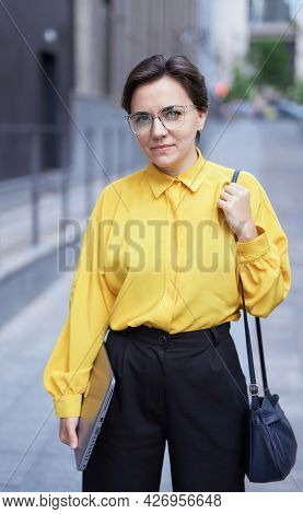 Closeup Portrait Of Attractive Businesswoman, Manager Or Finance Economist With Laptop Standing Near