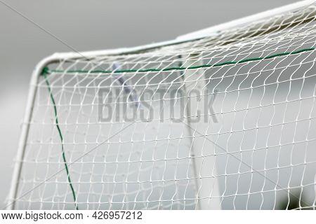 Soccer Football Equipment Background. White Soccer Net On A Goal. Soccer Net Nodes. Blurred Goal Pos