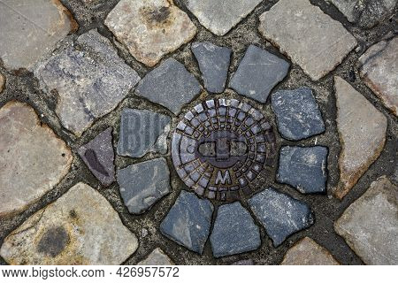 Paving Stone With Metal Canal Hatch.stone Block Road Pavement.
