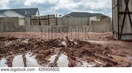 Residential House Construction Under Rain Delay With Mud And Tracks